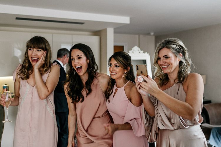 Bridesmaid First Look in Different Pink Dresses