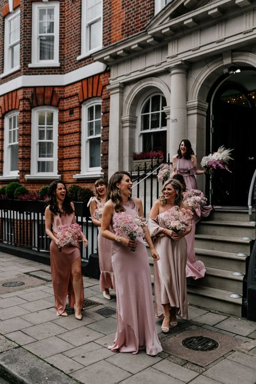 Bridesmaids in Different Pink Dresses with Pink Gypsophila Bouquets