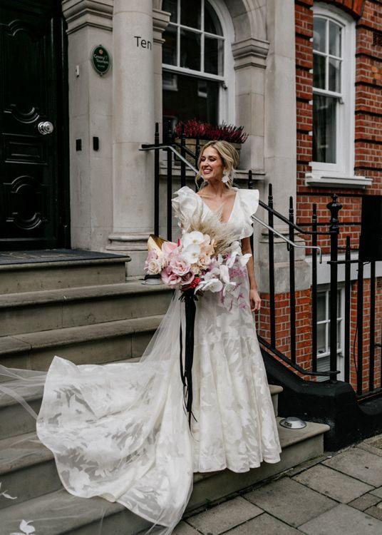 Bride in Jesus Peiro Crisalida Wedding Dress with Ruffle Sleeves