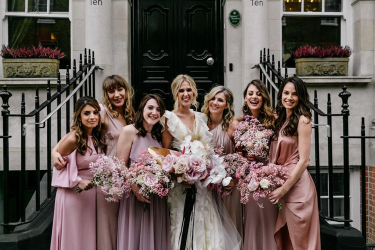 Pink and White Bouquets with Gypsophila, Peonies and Orchids