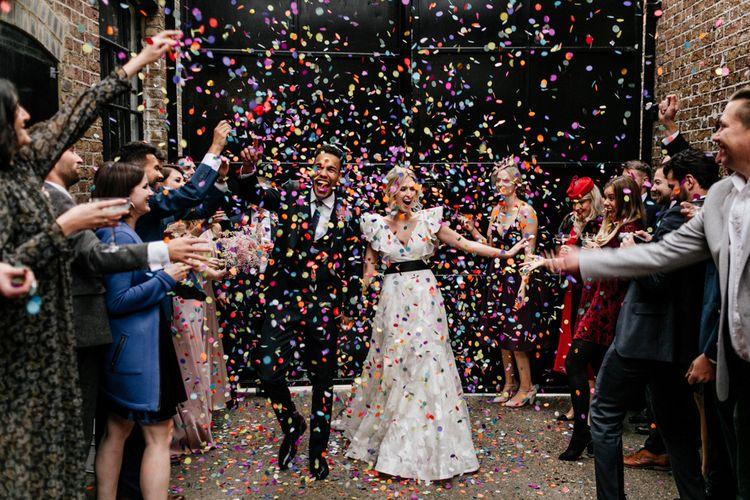 Colourful Confetti Moment with Bride in Ruffle Wedding Dress
