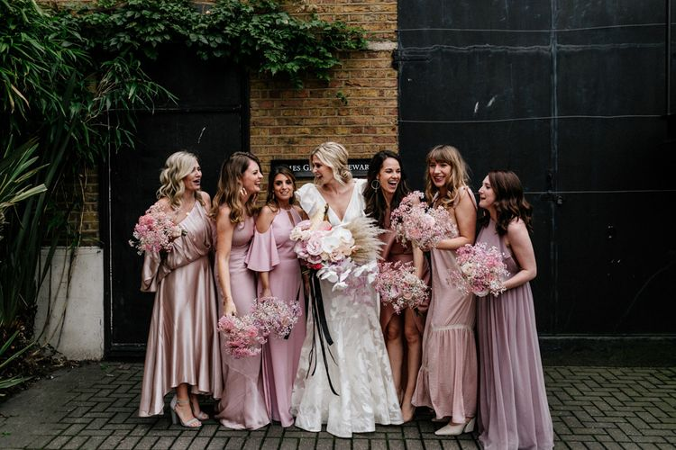 Bridesmaids in Different Pink Satin and Chiffon Dresses