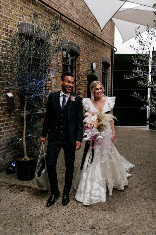 Stylish Bride and Groom in Ruffle Wedding Dress and Three Piece Suit