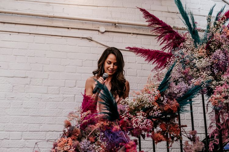 Bridesmaid Giving a Wedding Speech on the Steps Covered in Flowers