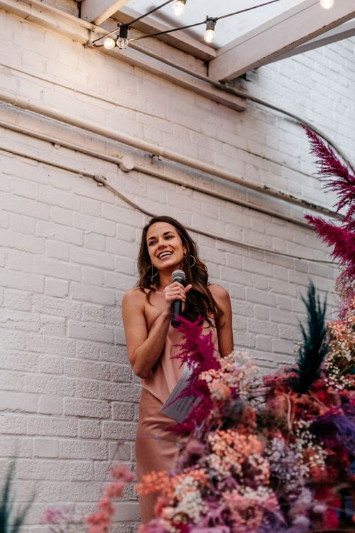Bridesmaid in Pink Dress Giving a Speech