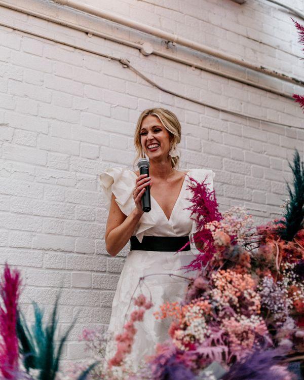 Bride in Ruffle Wedding Dress Giving a Wedding Speech
