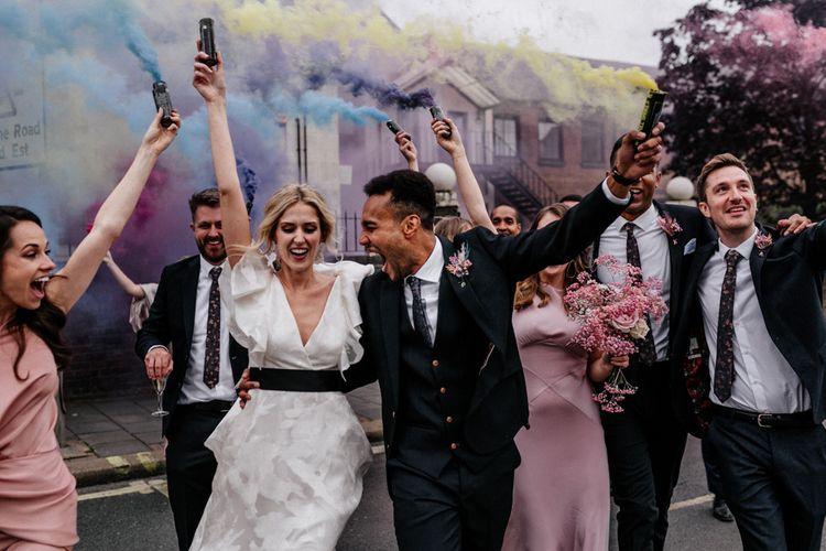 Bride in Ruffle Wedding Dress and Groom in Three Piece Navy Suit