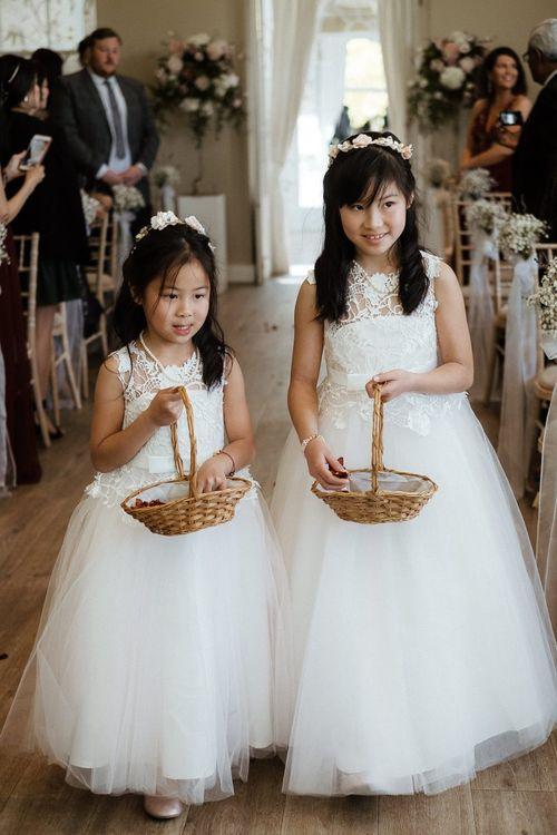 Flower girls during wedding ceremony in Essex