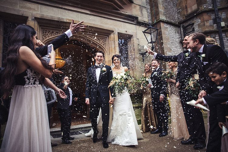 Confetti Exit with Bride in Lace Pronivias Dralia Wedding Dress and Groom in Cad and The Dandy Suit