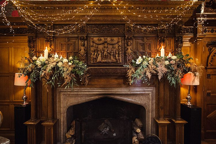 Fireplace Decorated with Fairy Lights and Flowers