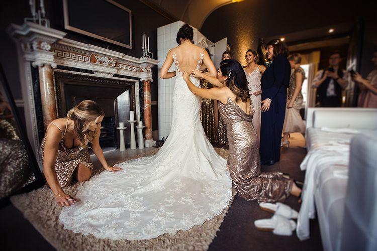 Bride Getting Ready in Lace Pronivias Dralia Wedding Dress