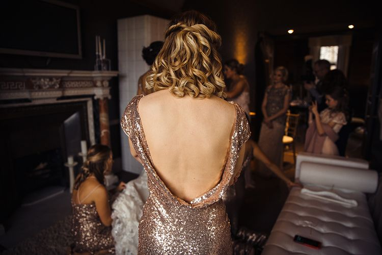 Bridesmaid in Low Back Gold Sequin Dress with Wavy Hair