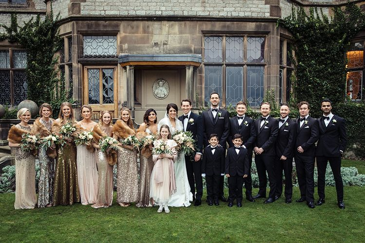 Wedding Party with in Bride in Lace Pronivias Dralia Wedding Dress, Bridesmaids in Gold Sequin Dresses and Groomsmen in Black Tie