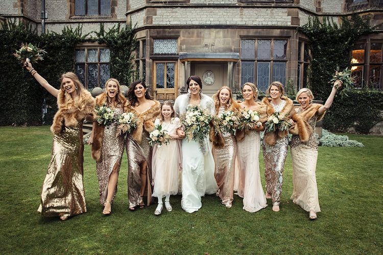 Bridal Party with Bride in Lace Pronivias Dralia Wedding Dress and Bridesmaids in Gold Sequin Dresses