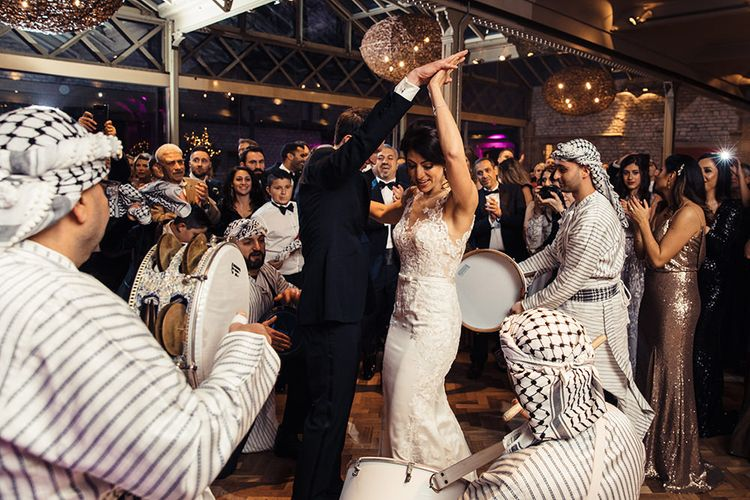Bride and Groom Dancing to the Zaffa Band