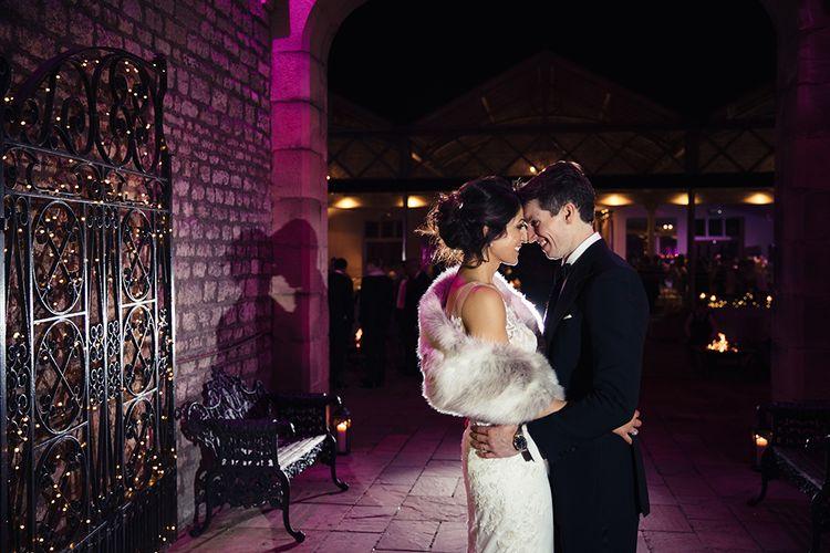 Bride in Lace Pronivias Dralia Wedding Dress and Groom in Black Tie Suit