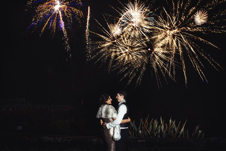New Year's Eve Fireworks Display with Bride in Lace Pronivias Dralia Wedding Dress and Groom in Black Tie Suit