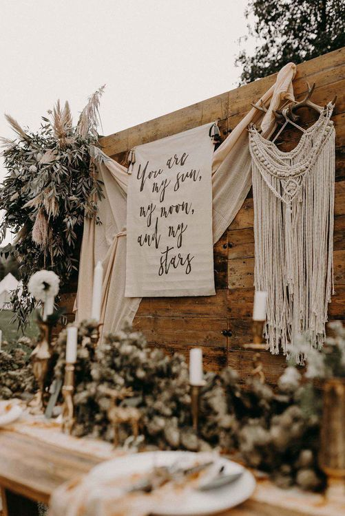 Rustic Tablescape with Drapes, Fabric Flag Backdrop, Dried Flowers & Macrame Hanging | Nude Bohemian Wedding Inspiration by Wonderland Invites & Rock The Day Styling | Kelsie Low Photography