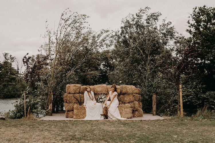 Hay Bale Seating Area | Boho Brides in Lace Dresses from Rock The Frock Bridal | Nude Bohemian Wedding Inspiration by Wonderland Invites & Rock The Day Styling | Kelsie Low Photography