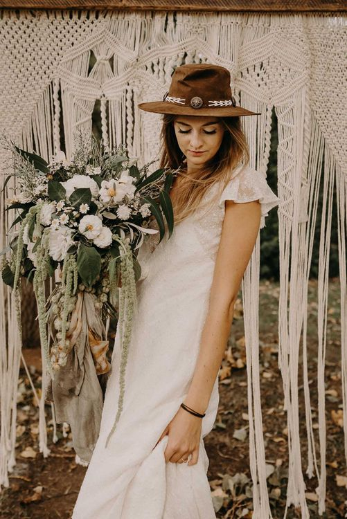 Boho Bride in Hat & Lace Rock The Frock Bridal Gown | Macrame Wall Hanging & Dried Flowers | Nude Bohemian Wedding Inspiration by Wonderland Invites & Rock The Day Styling | Kelsie Low Photography