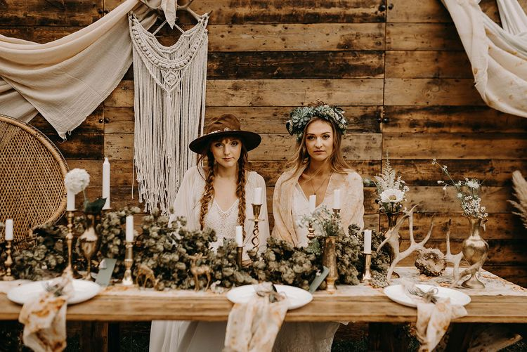 Boho Brides in Lace Dresses, Hats & Succulent Flower Crowns | Drapes, Dried Flowers & Macrame Decor | Wooden Table with Candle Sticks & Greenery Garland | Nude Bohemian Wedding Inspiration by Wonderland Invites & Rock The Day Styling | Kelsie Low Photography