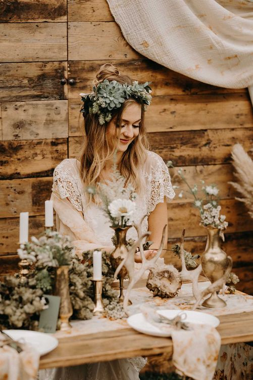 Boho Bride in Lace Dress & Succulent Flower Crowns | Drapes, Dried Flowers & Macrame Decor | Wooden Table with Candle Sticks & Greenery Garland | Nude Bohemian Wedding Inspiration by Wonderland Invites & Rock The Day Styling | Kelsie Low Photography