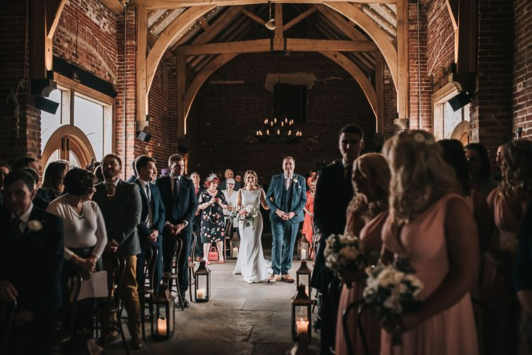 Here she comes | Blush Pink and Copper | RMW The List Members Hazel Gap Barn, Nottinghamshire | Mikaella Bridal Gown | Pear and Bear Photography