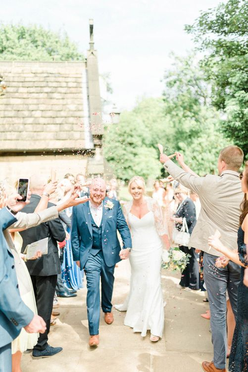 Confetti Moment with Bride in Suzanne Neville Wedding Dress and Lace Bolero and Groom in Navy Hugo Boss Suit