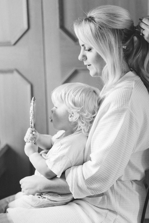 Bride in Getting Ready Robe with Son on Her Lap