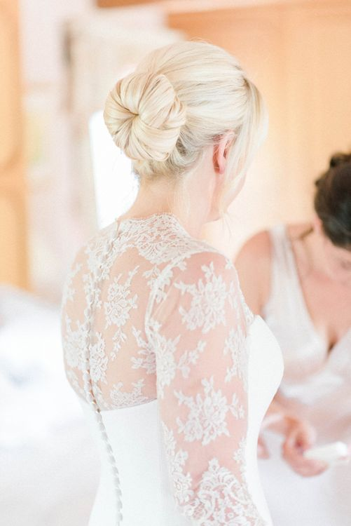 Bride in Lace Bolero over Suzanne Neville Wedding Dress with Chic Bridal Up Do