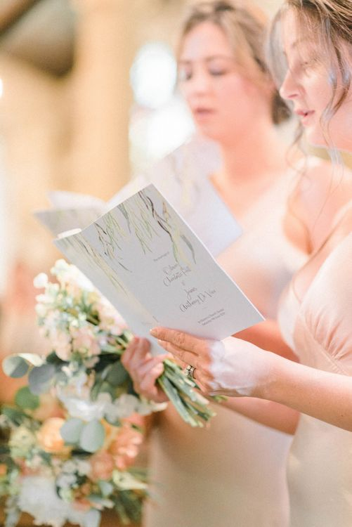 Bridesmaid Holding Order of Service on the Day Wedding Stationery