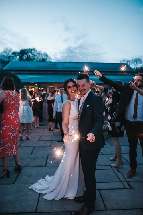 Sparklers on exit | Blush Pink and Copper | RMW The List Members Hazel Gap Barn, Nottinghamshire | Mikaella Bridal Gown | Pear and Bear Photography