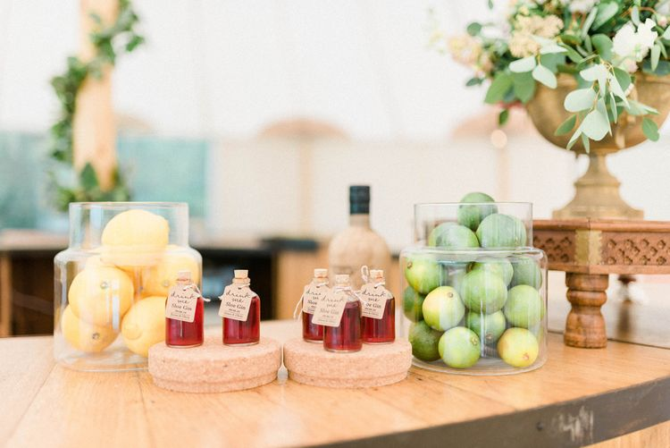 Glass Jars Filled with Oranges and Limes and Miniature Alcohol Wedding Favours