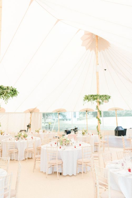 PapaKata Sperry Tent Reception with Greenery Wrapped around The Poles and Hanging Chandeliers
