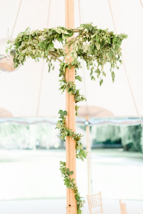 Foliage Hoop Chandeliers and Foliage Wrapped Around Poles