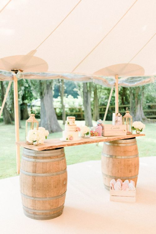 Wooden Barrel Cake Table with Semi Naked Wedding Cake, Lanterns and Flowers to Decorate