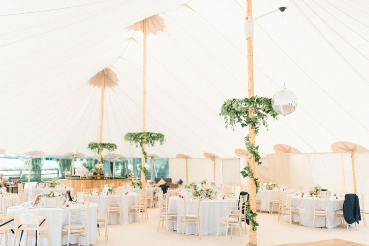 PapaKata Sperry Tent Reception with Foliage Wrapped around Poles and Greenery Chandeliers