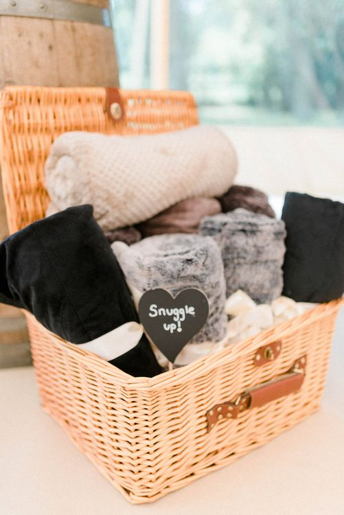 Wicker Basket Filled with Blankets to Snuggle Up