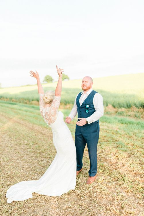 Bride in Suzanne Neville Wedding Dress and Lace Bolero and Groom in Hugo Boss Waistcoat and Trousers Celebrating