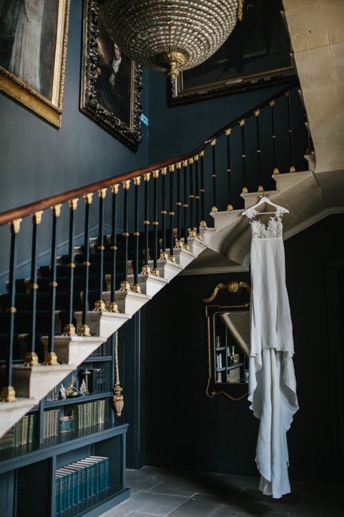 Pronovias Wedding Dress Hanging From the Stairs