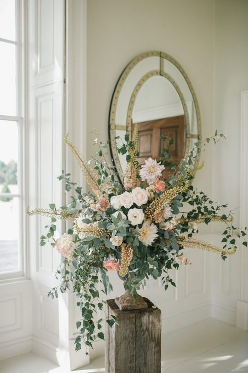 Floral Arrangement with Eucalyptus, Roses and Grasses