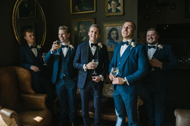 Groomsmen in Three-piece Navy Suits and Bow Ties