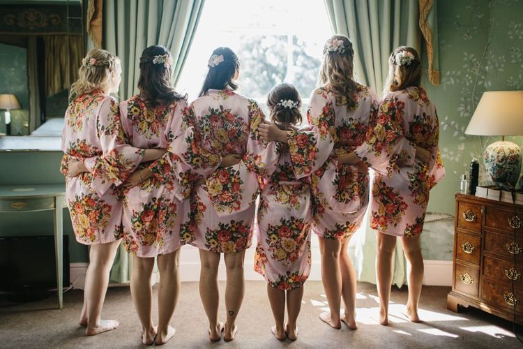 Bridal Party in Matching Floral Robes on The Wedding Morning