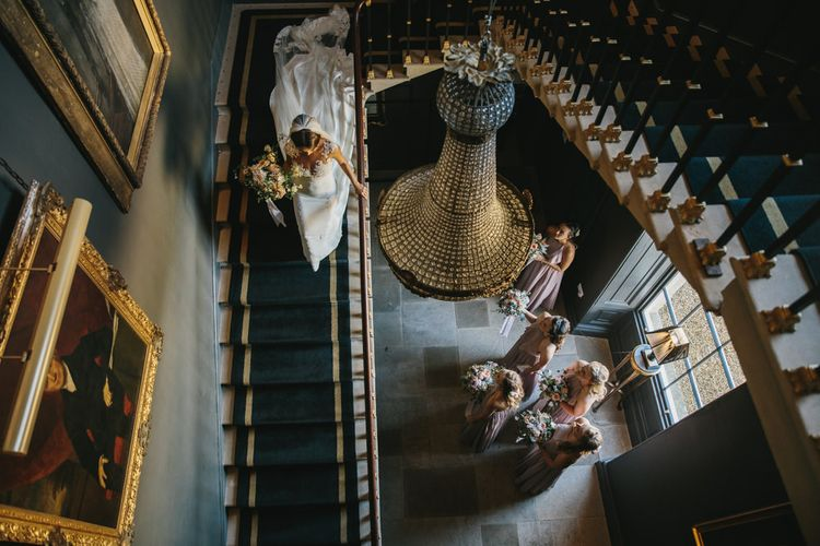 Bride in Pronovias Wedding Dress Walking Down the Stairs