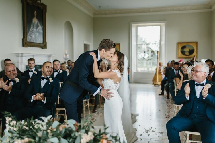 Bride and Groom Kissing at Wedding Ceremony at Stubton Hall