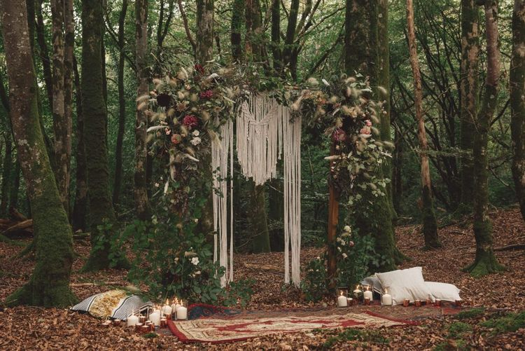 Wedding Ceremony Altar in the Woods with Macrame, Foliage and Dried Grass Decor