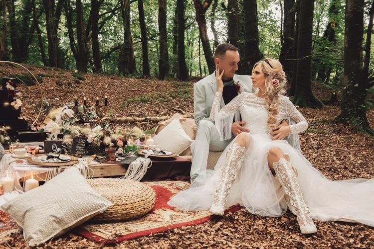 Bride in Long Sleeve Wedding Dress with Fringe Detail and White Lace Boots