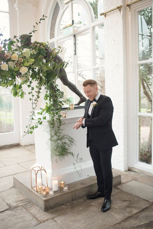 Groom in Black Tie Suit | Super Luxe White, Grey & Gold Elegant Wedding Inspiration at Orangery, Holland Park, Kensington, London | Planned & Style day The Events Designers | Eva Tarnok Photography