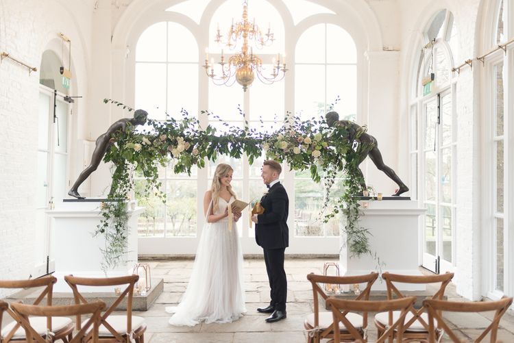 Altar Floral Installation | Bride in Nissa Now  from Chic Nostalgia | Groom in Black Tie Suit | Super Luxe White, Grey & Gold Elegant Wedding Inspiration at Orangery, Holland Park, Kensington, London | Planned & Style day The Events Designers | Eva Tarnok Photography