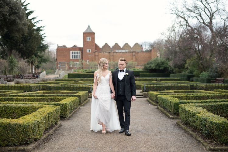 Bride in Nissa Now  from Chic Nostalgia | Groom in Black Tie Suit | Super Luxe White, Grey & Gold Elegant Wedding Inspiration at Orangery, Holland Park, Kensington, London | Planned & Style day The Events Designers | Eva Tarnok Photography
